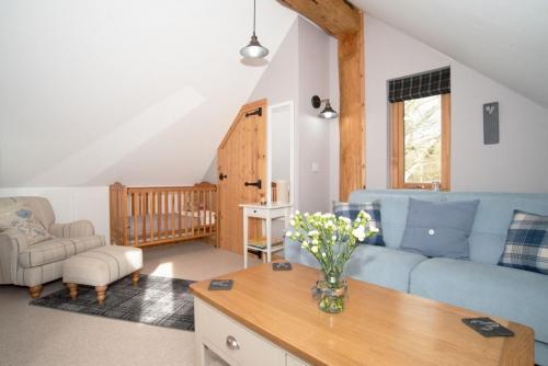 Upstairs Sofa and Baby Crib