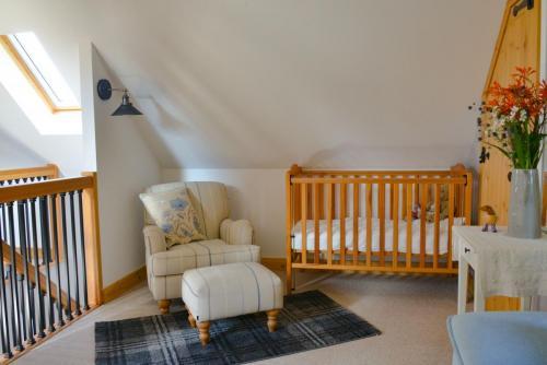 Upstairs crib and sofa